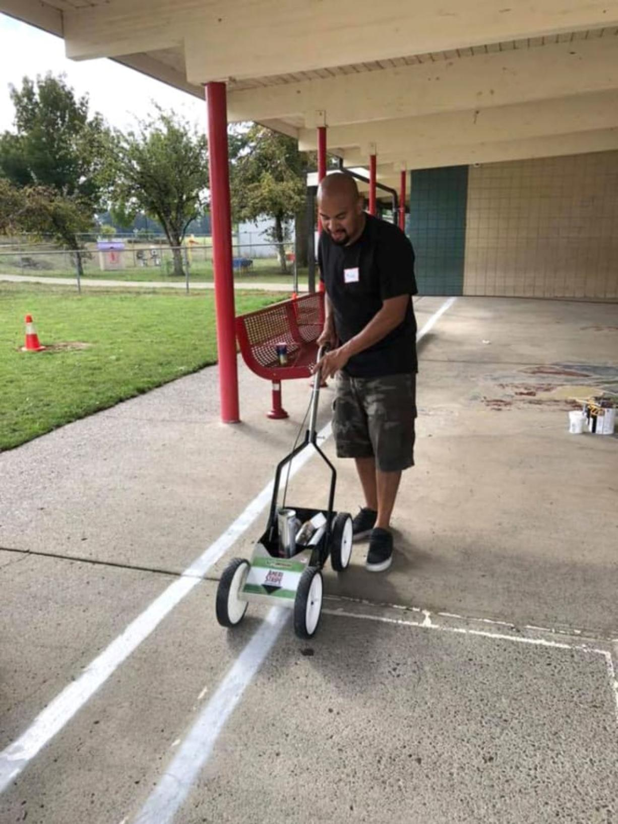 BATTLE GROUND: The local parent teachers organization for Glenwood Heights Primary School worked to beautify the playground recently. Volunteers power washed the grounds and painted new games, as well as provided more equipment for students to play with.