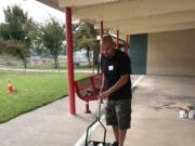 BATTLE GROUND: The local parent teachers organization for Glenwood Heights Primary School worked to beautify the playground recently.
