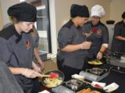 WASHOUGAL: Washougal High School Advanced Culinary students Zoie Petersen, Jovanna White, Ashlyn James and Rebecca McDonald work to serve up pasta to students and faculty on Sept.