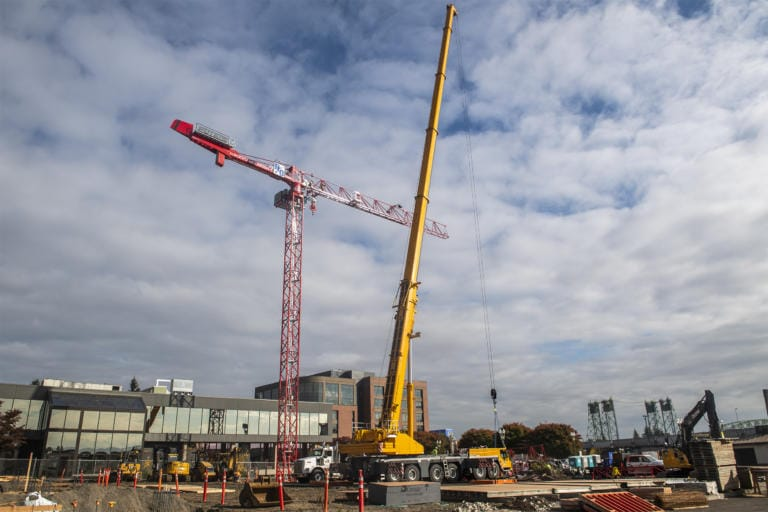 Crews work to assemble a tower crane in downtown Vancouver at the future site of the Aria Apartments on Monday afternoon, Oct. 7, 2019. (Nathan Howard/The Columbian)