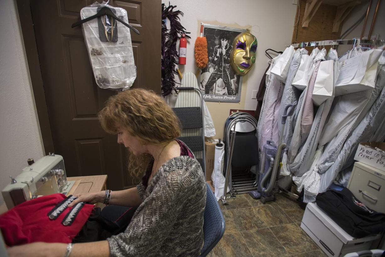 """Center Stage Clothiers owner Diana Kirkpatrick works on a pirate costume for a production of """"Peter Pan"""" at Evergreen High School this fall. Local schools are a large part of the business, which she opened in January 2018."""