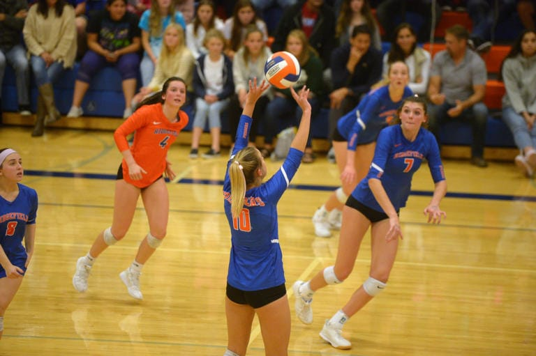Ridgefield junior Morgan Harter sets the ball for teammate Alicia Andrew during a game against Columbia River at Ridgefield High School on Tuesday, October 8, 2019. Ridgefield won all three sets against Columbia River. (Samuel Wilson for the Columbian)