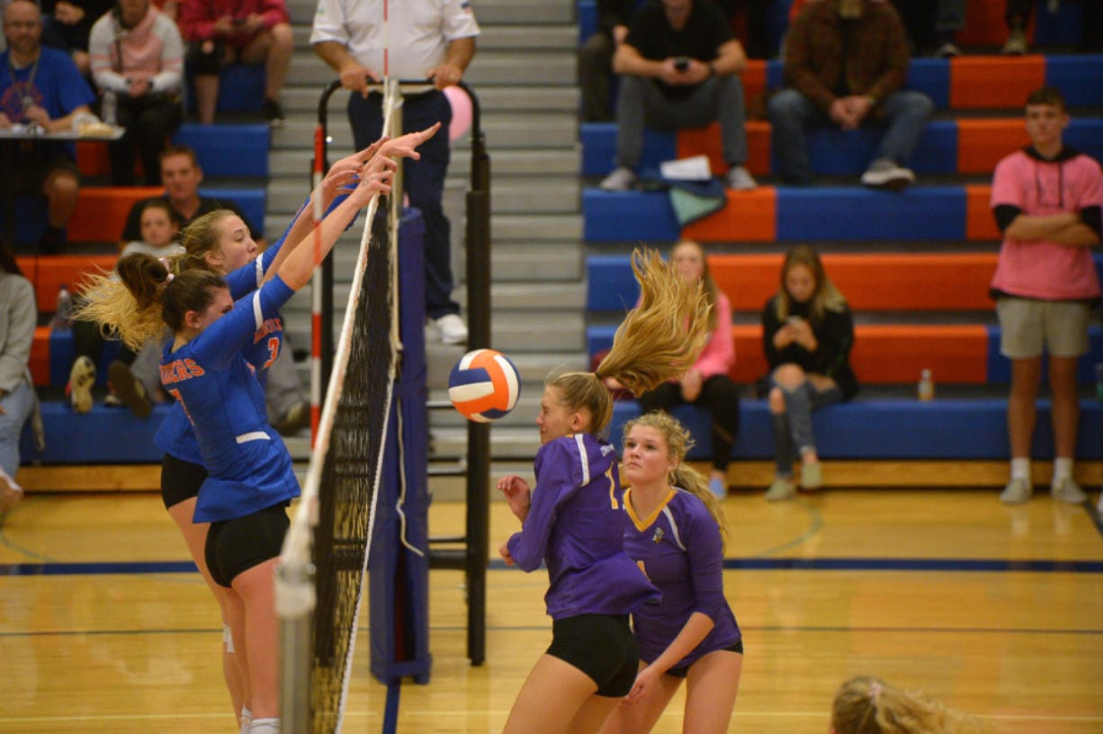Ridgefield's Allie Andrew and Delaney Nicoll stuff Columbia River's Isabella Ness during Tuesday's 2A Greater St. Helens League match at Ridgefield High School. (Samuel Wilson for The Columbian)
