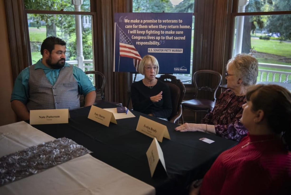 U.S. Sen. Patty Murray, second from left, discusses veterans' health care issues on Wednesday with military veterans Nate Patterson, from left, Evelyn Brady and Tonya Wark at The Marshall House in Vancouver. Murray was looking for feedback on a new health care system administered by the Department of Veterans Affairs.