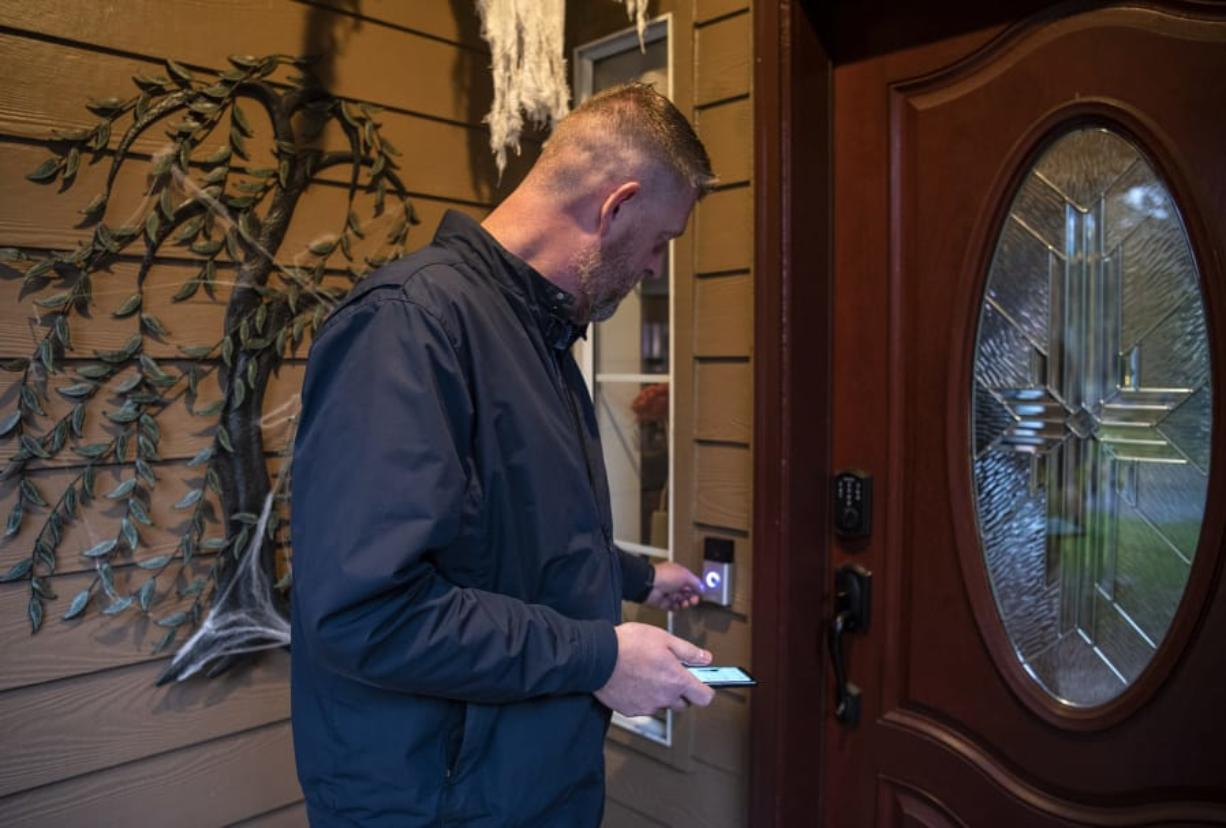 Matt Wiles shows off his Ring camera system at his home in east Vancouver on Wednesday. Wiles was an early adopter of the home camera system and purchased one right after they were released in 2013.