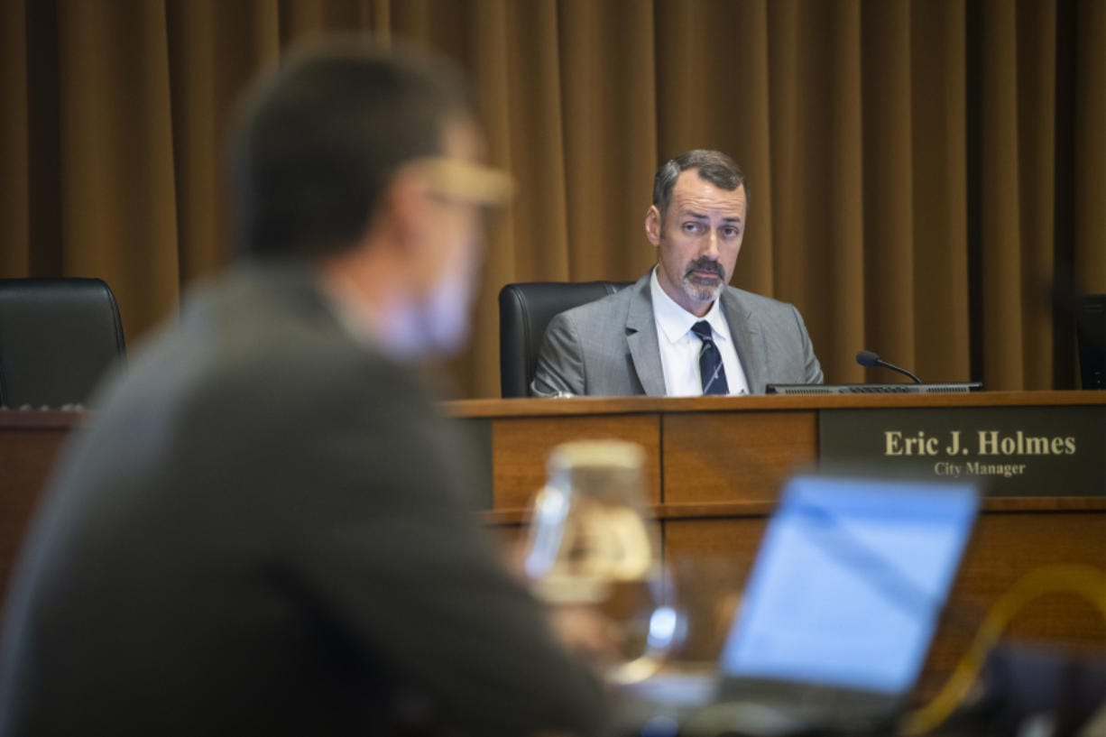 Vancouver City Manager Eric Holmes listens to council deliberations during a city council work session on Monday. Holmes is the highest-paid city employee in the greater Portland metro area.
