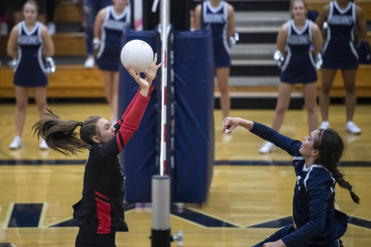 Camas' Alliyah Barnes blocks a hit from Skyview's Allyson Reid during the 4A Greater St. Helens League match Tuesday at Skyview. Camas won 3-0.