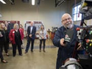 Mechatronics instructor Larry Smith greets guests during a tour at Clark College's Columbia Tech Center campus Monday. The tour was part of the 10th anniversary celebration of the facility.