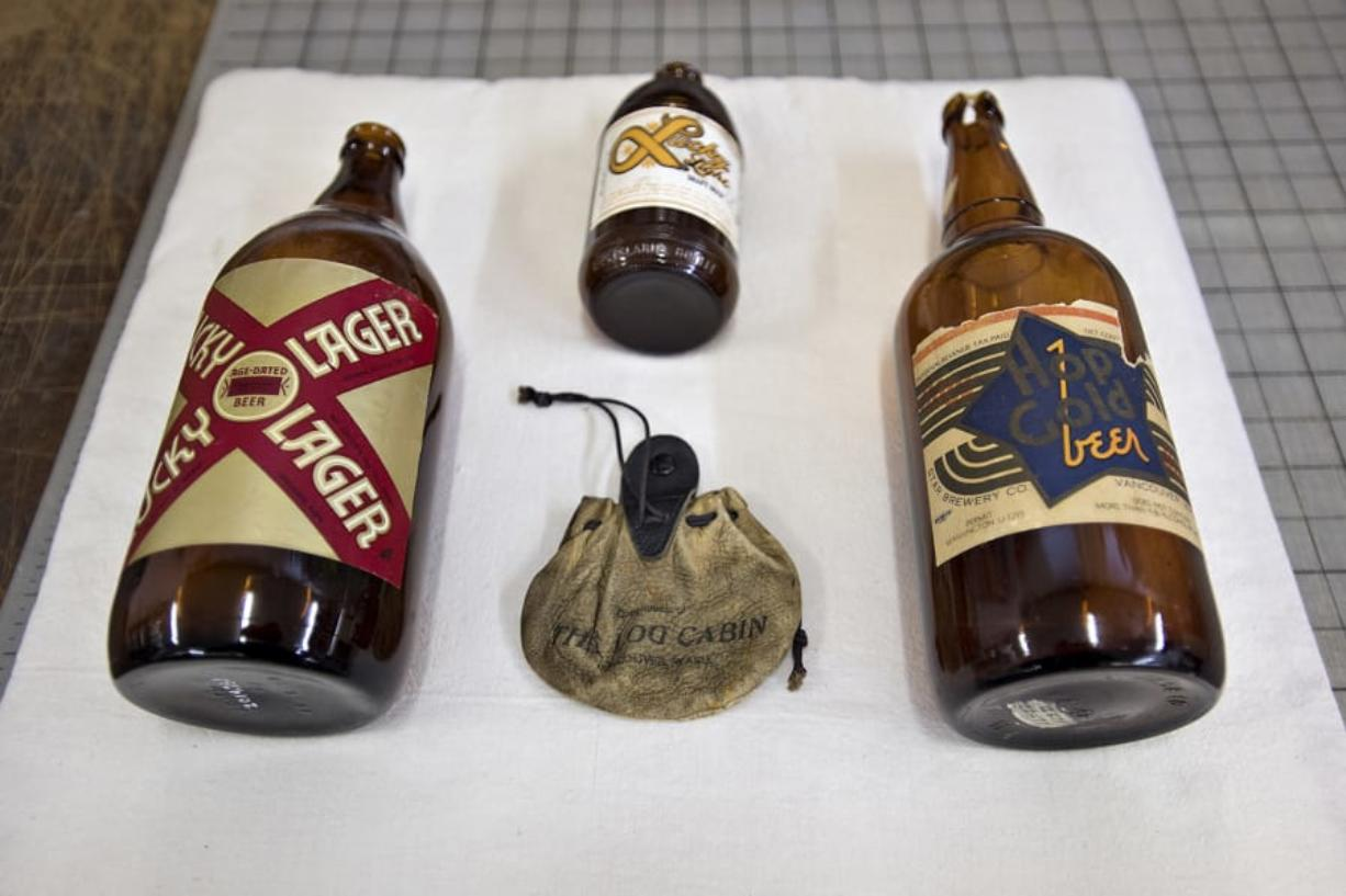 A few historical beer bottles, including one from 1918, right, wait to be displayed at the Clark County Historical Museum. The items needed to be cleaned and assessed by James Kice before display.