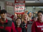 """More than 50 members of the Oregon Federation of Nurses and Health Professionals hold a rally and march through PeaceHealth Southwest Medical Center to support the union's bargaining team on Wednesday. L.C. stands for """"low census,"""" which refers to staff members having short-notice shift cancellations. This situation can lead to staff members having to take PTO to fill the gaps in their hours for the week."""