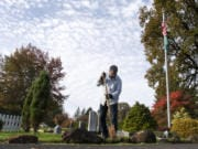 William Zalpys clears away moss buildup on the side of the path at the Fern Prairie Cemetery in Camas. Zalpys has led the cemetery district in the outskirts of Camas since April 2002. He wears many hats in his position, one of which includes groundskeeping, but not grave digging. Cemetery commissioners are elected to six-year terms. Zalpys' term ends in 2023.