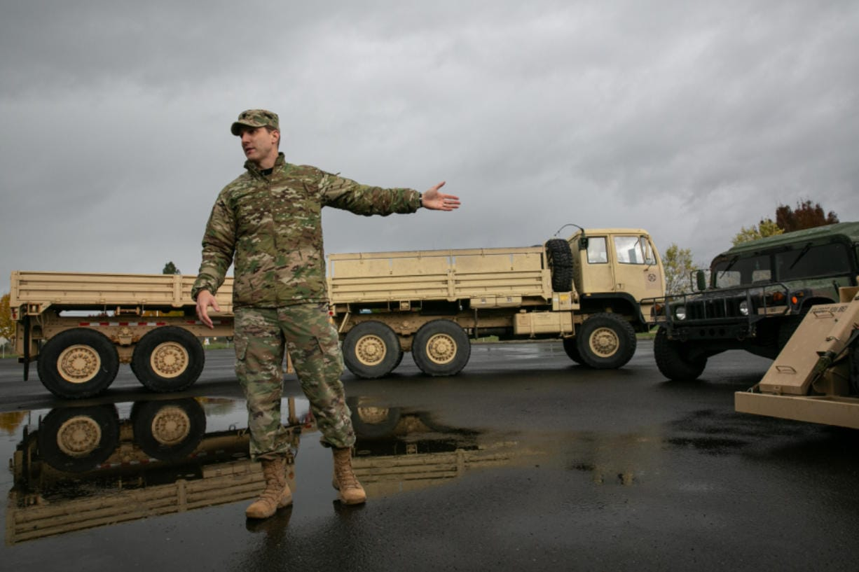 Cmdr. Josh Barrow provides an overview of Bravo Company's vehicles during an open house at the Armed Forces Reserve Center on Saturday afternoon. (Elayna Yussen for The Columbian)