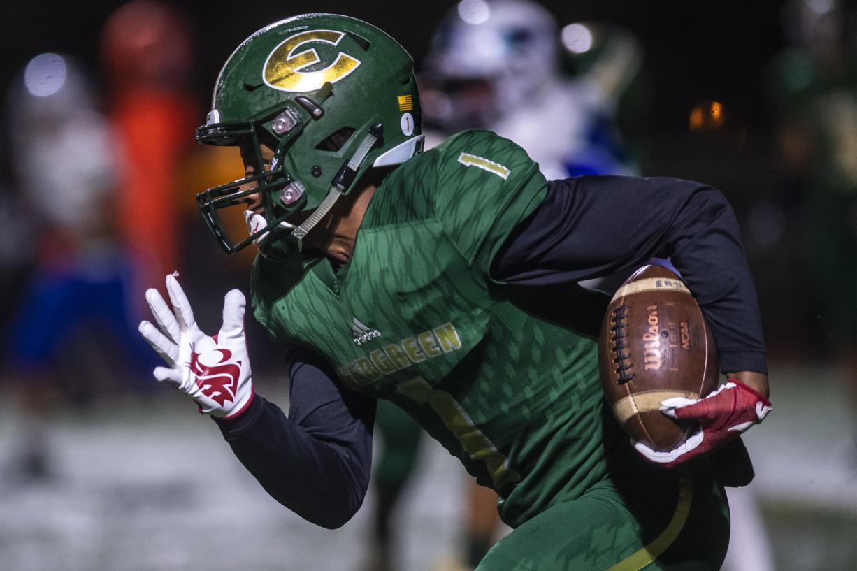 Evergreen Zyell Griffin runs the ball against Mountain View during a game at McKenzie Stadium on Friday night, Oct. 18, 2019.
