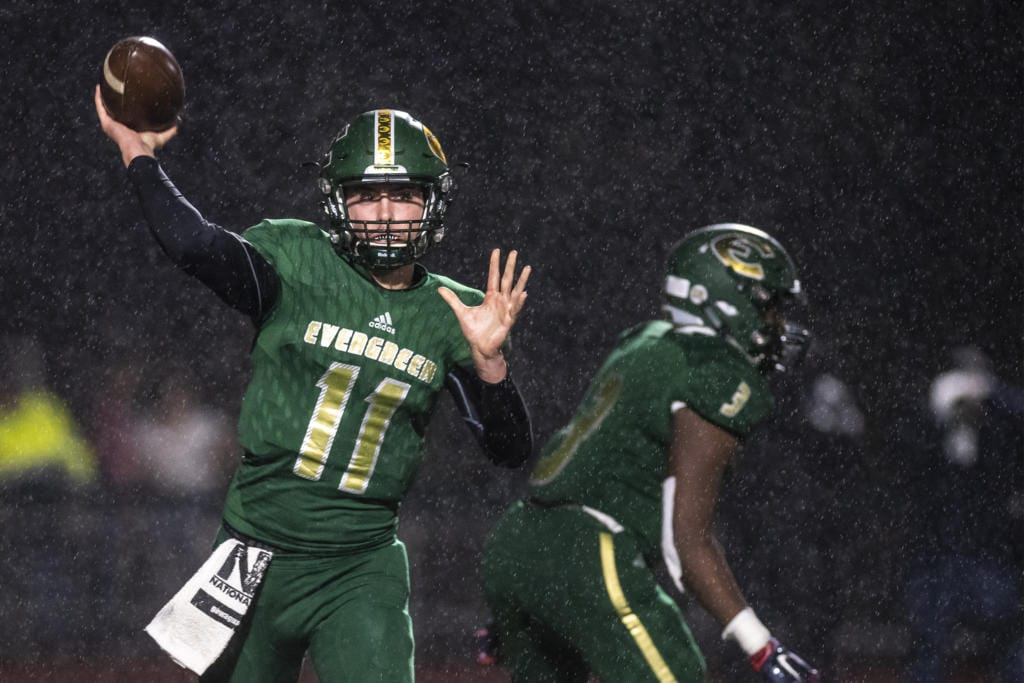 Evergreen's Carter Monda throws the ball against Mountain View during a game at McKenzie Stadium on Friday night, Oct. 18, 2019.