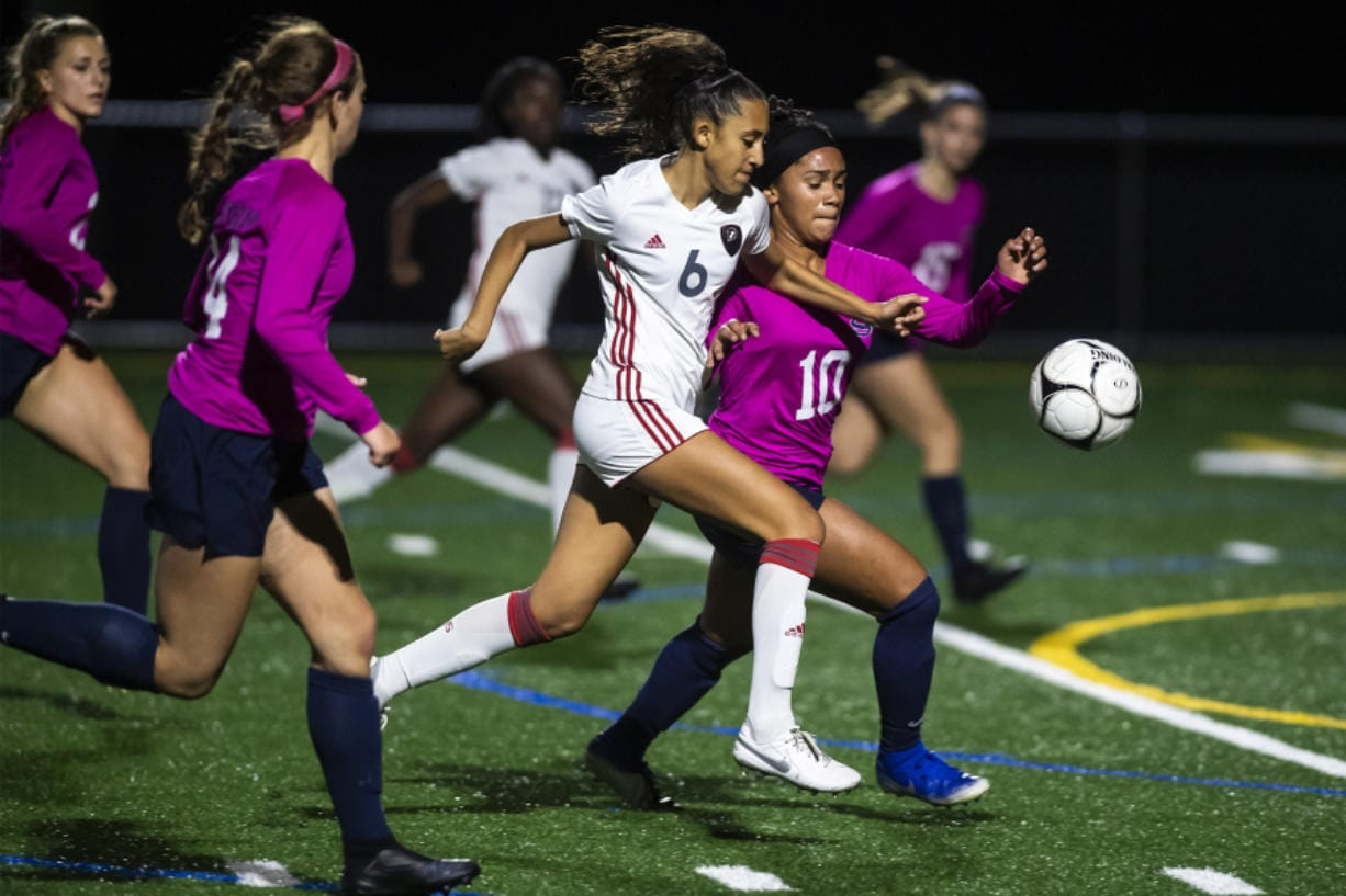 UnionCfUs Maya Woods and SkyviewCfUs Olivia Calton battle for the ball as Woods drives into Skyview territory during a game at Skyview High School on Tuesday night, Oct. 22, 2019.
