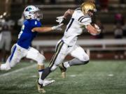 Kelso's Josh Webb evades Mountain View's Davis Delmage to rush for a 77-yard touchdown during a game at McKenzie Stadium on Friday night, Oct. 25, 2019.