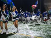 Mountain View runs onto the field before a game against Kelso at McKenzie Stadium on Friday night, Oct. 25, 2019.