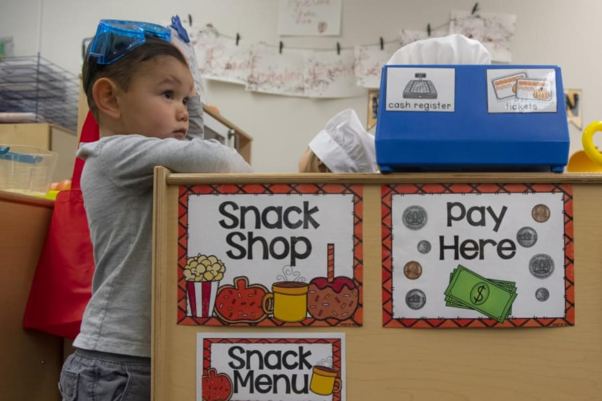 Austin Park, 3, watches a tour as school district patrons visit his class in the Early Learning Center at the Ridgefield Administrative and Civic Center.