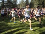 Runners take off from the starting line during the 2A Boys District Cross Country meet at Lewis River Golf Course on Thursday afternoon, Oct. 31, 2019.