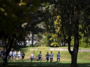 Runners compete in the 2A Boys District Cross Country meet at Lewis River Golf Course Thursday near Woodland.