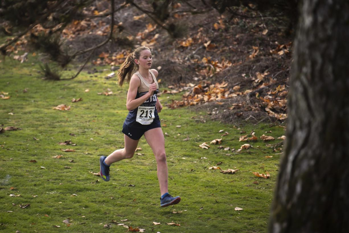 Seaton's Lara Carrion leads the race during the 1A Girls District Cross Country meet at Lewis River Golf Course on Thursday afternoon, Oct. 31, 2019.  Seton Catholic is one of the school interested in running with Columbia High School in White Salmon if they can make some cross country meets happen this fall.