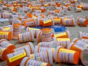 Protesters dropped hundreds of fake prescription bottles of OxyContin during a demonstration last month in front of Purdue Pharma headquarters in Stamford, Conn. Purdue is the manufacturer of OxyContin.