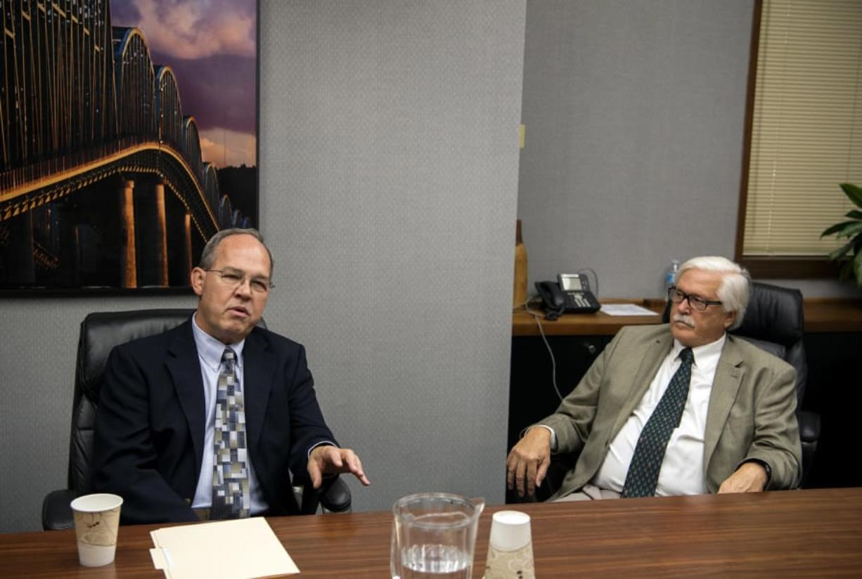 Port of Vancouver commissioner candidates Jack Burkman, left, and Dan Barnes speak with The Columbian's Editorial Board on Sept. 26.