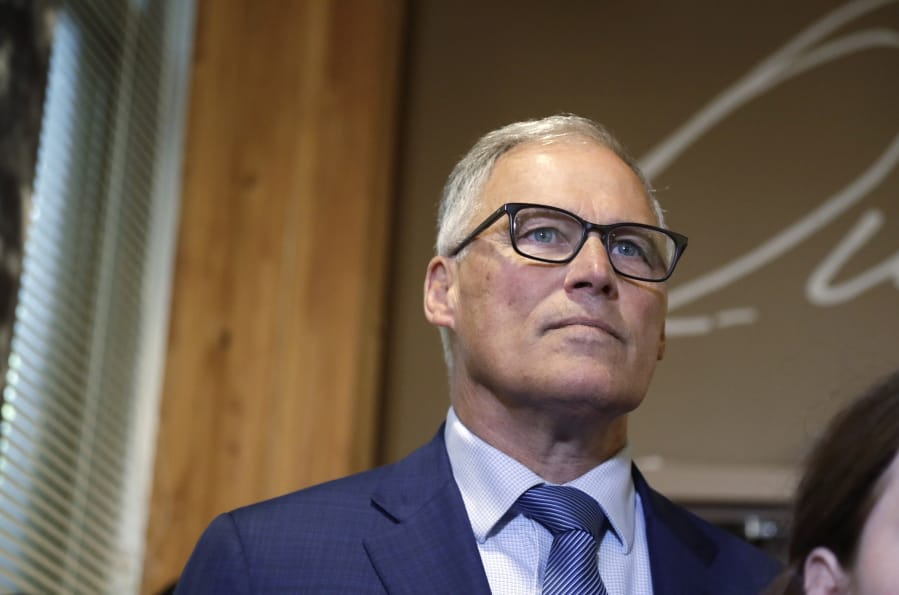 Washington Gov. Jay Inslee listens during a news conference Aug. 22 in Seattle. (Associated Press files)