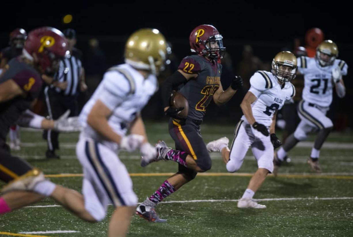 Prairie's Dustin Shelby (22) runs an 80-yard touchdown during Friday night's game at District Stadium in Battle Ground. Prairie beat Kelso 38-22.