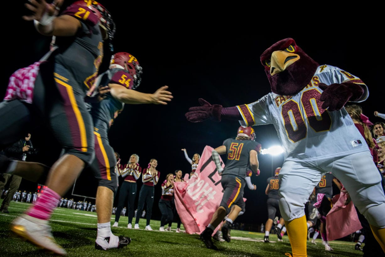 Prairie runs onto the field after halftime during Friday night's game at District Stadium in Battle Ground on Oct. 4, 2019. Prairie won 38-22. (Alisha Jucevic/The Columbian)