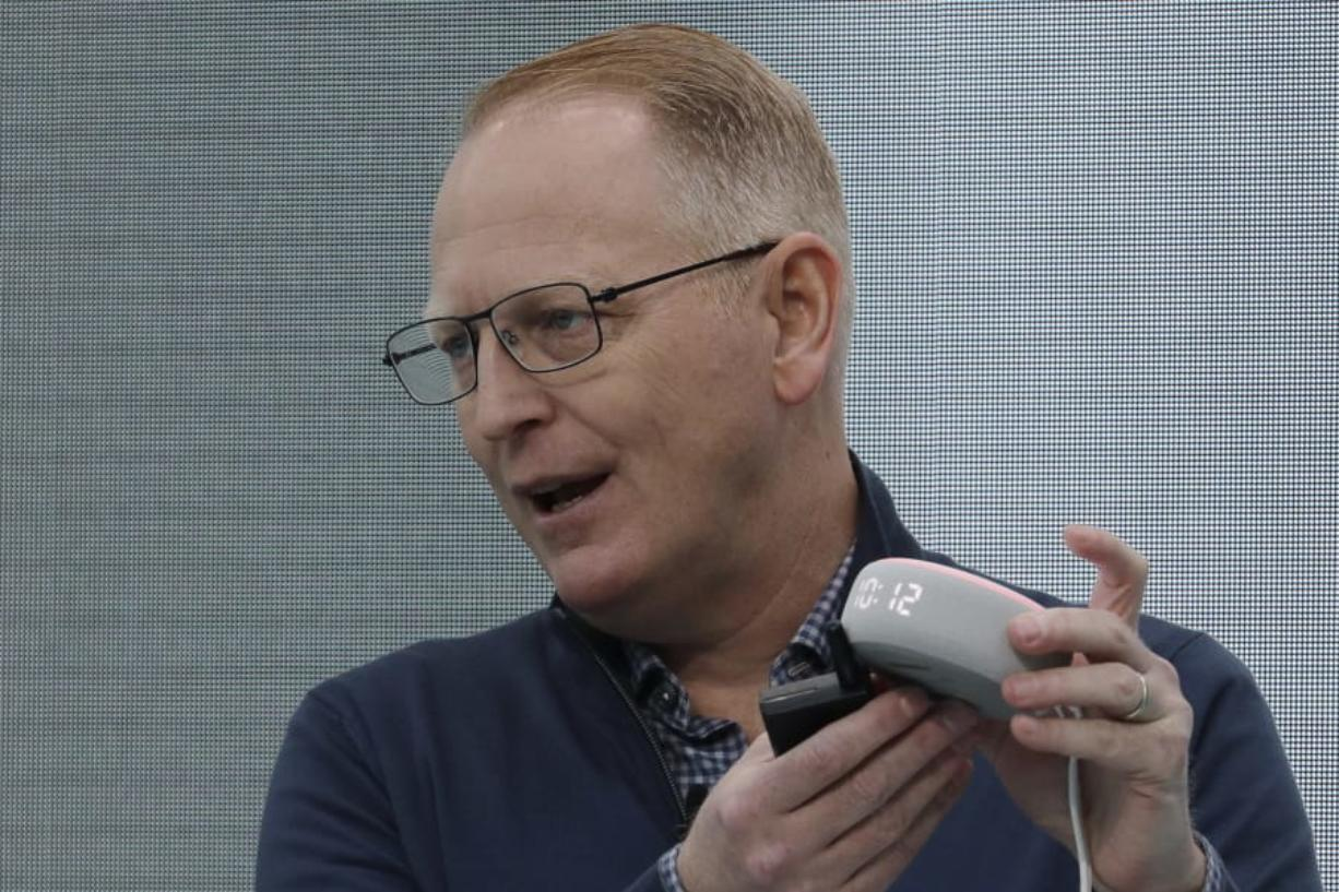 Dave Limp, senior vice president for Amazon devices & services, holds a new Echo Dot with Clock device as he speaks Wednesday, Sept. 25, 2019, at an event in Seattle to unveil new products that work with the company's Alexa smart devices line. (AP Photo/Ted S.