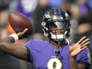 Baltimore Ravens quarterback Lamar Jackson works out prior to an NFL football game against the Cincinnati Bengals Sunday, Oct. 13, 2019, in Baltimore.