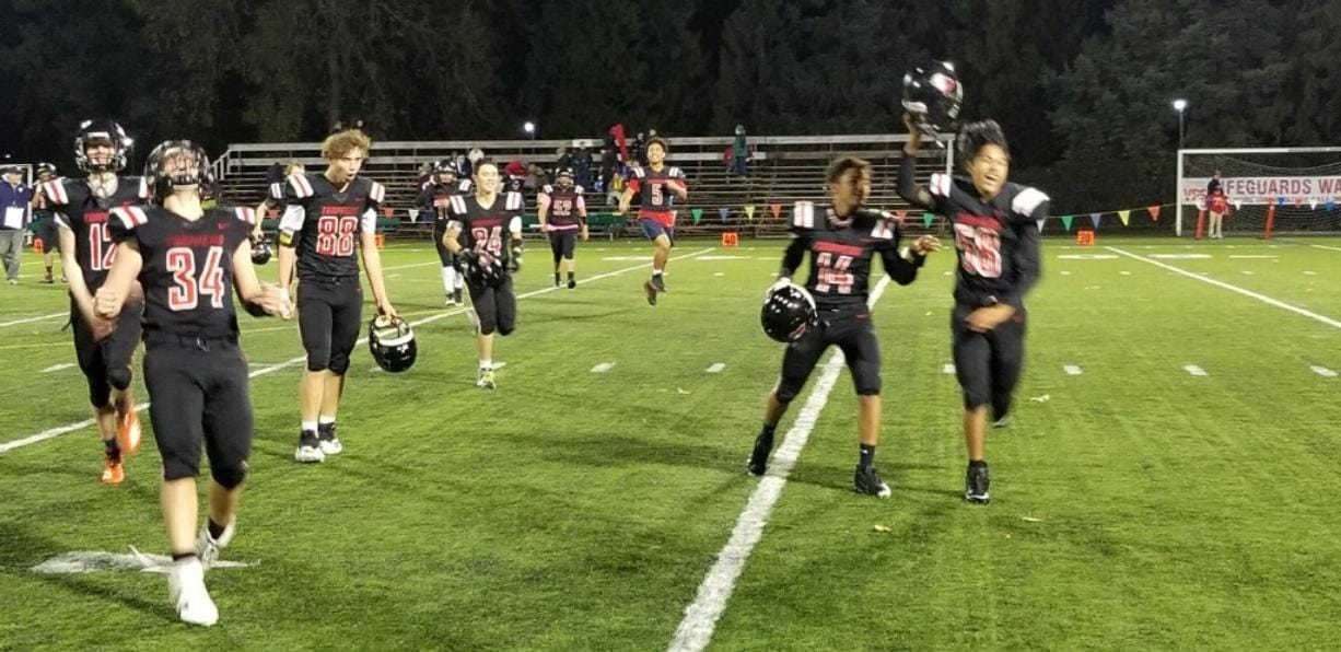 Fort Vancouver celebrates its first win, 32-22 over Northwest Christian (Lacey), in the past 31 games on Friday at Kiggins Bowl.