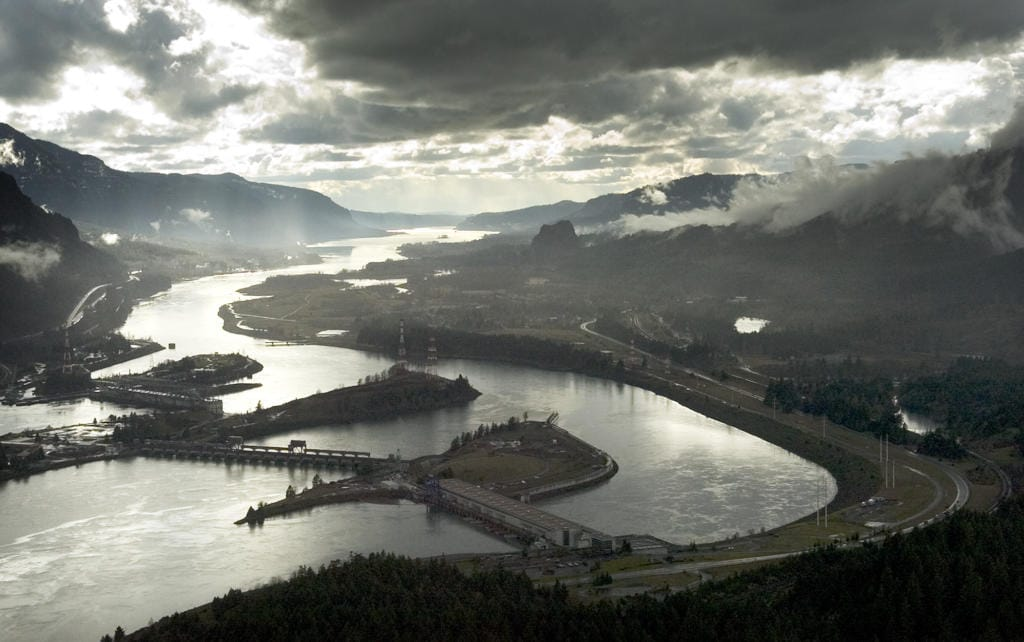 Aerial photograph of the Columbia River Gorge looking west with Bonneville Dam in the foreground.