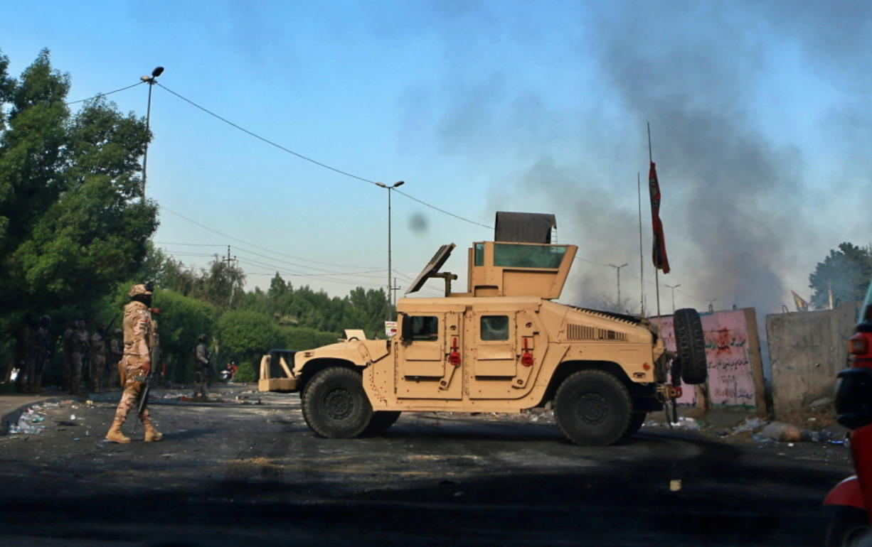 Iraqi Army troops deploy at a site of protests in Baghdad, Iraq, Sunday, Oct. 6, 2019. The spontaneous protests which started Tuesday in Baghdad and southern cities were sparked by endemic corruption and lack of jobs. Security forces responded with a harsh crackdown, with dozens killed.