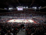 The Portland Trail Blazers and the Denver Nuggets play in the opening seconds of an NBA preseason basketball game at Memorial Coliseum in Portland, Ore., Tuesday, Oct. 8, 2019.