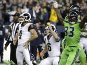 Los Angeles Rams' Greg Zuerlein (4) and Seattle Seahawks free safety Tedric Thompson (33) react after Zuerlein missed a field goal in the final seconds of an NFL football game Thursday, Oct. 3, 2019, in Seattle. The Seahawks won 30-29.