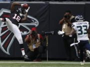 tlanta Falcons wide receiver Calvin Ridley (18) makes the catch for a two-point conversion against Seattle Seahawks free safety Tedric Thompson (33) during the second half of an NFL football game, Sunday, Oct. 27, 2019, in Atlanta.