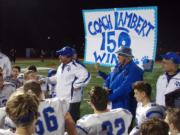 La Center football coach John Lambert talks to his players after beating King's Way Christian on Friday for his 150th career win (Tim Martinez/The Columbian)