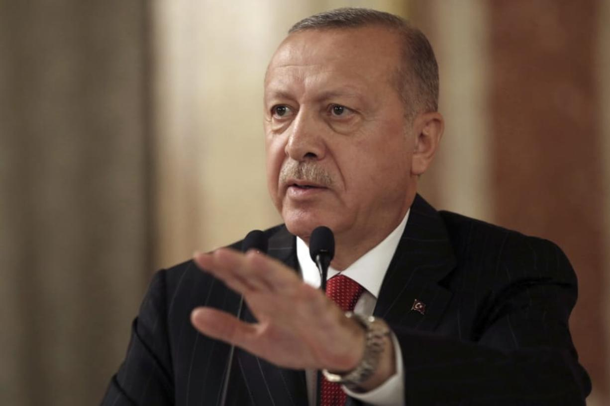 "Turkey's President Recep Tayyip Erdogan addresses a conference of parliament speakers in Istanbul, Friday, Oct. 11, 2019. Erdogan says his county ""will not take a step back"" from its offensive against Syrian Kurdish militants it sees as a national security threat, defying serious warnings from the United States and other Western nations. (Presidential Press Service via AP, Pool)"