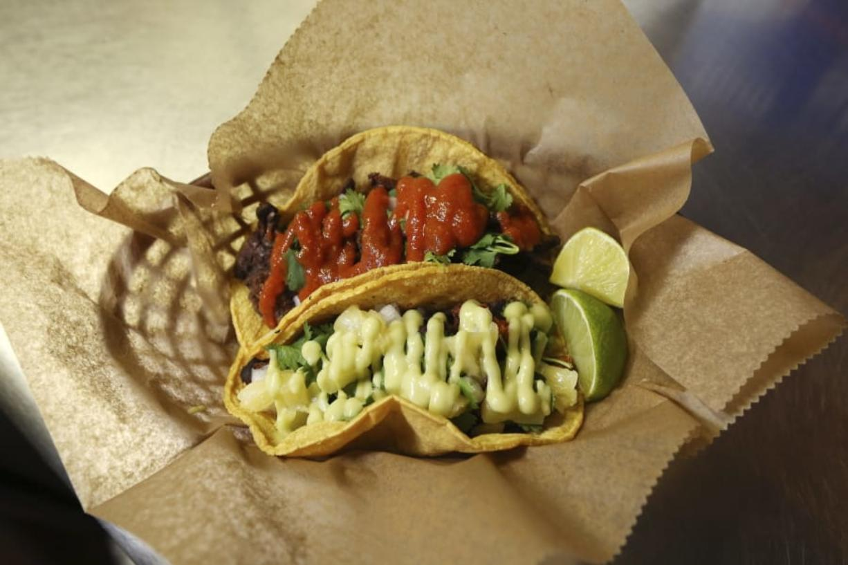 Fresh tacos served up at the Mi Vegana Madre restaurant offering Mexican vegan food in Glendale, Ariz. No longer just a few items on a mainstream restaurant's menu, vegan Mexican food has become a widening industry on its own with Latinos taking control of the kitchen. (AP Photo/Ross D. Franklin) (Ross D.