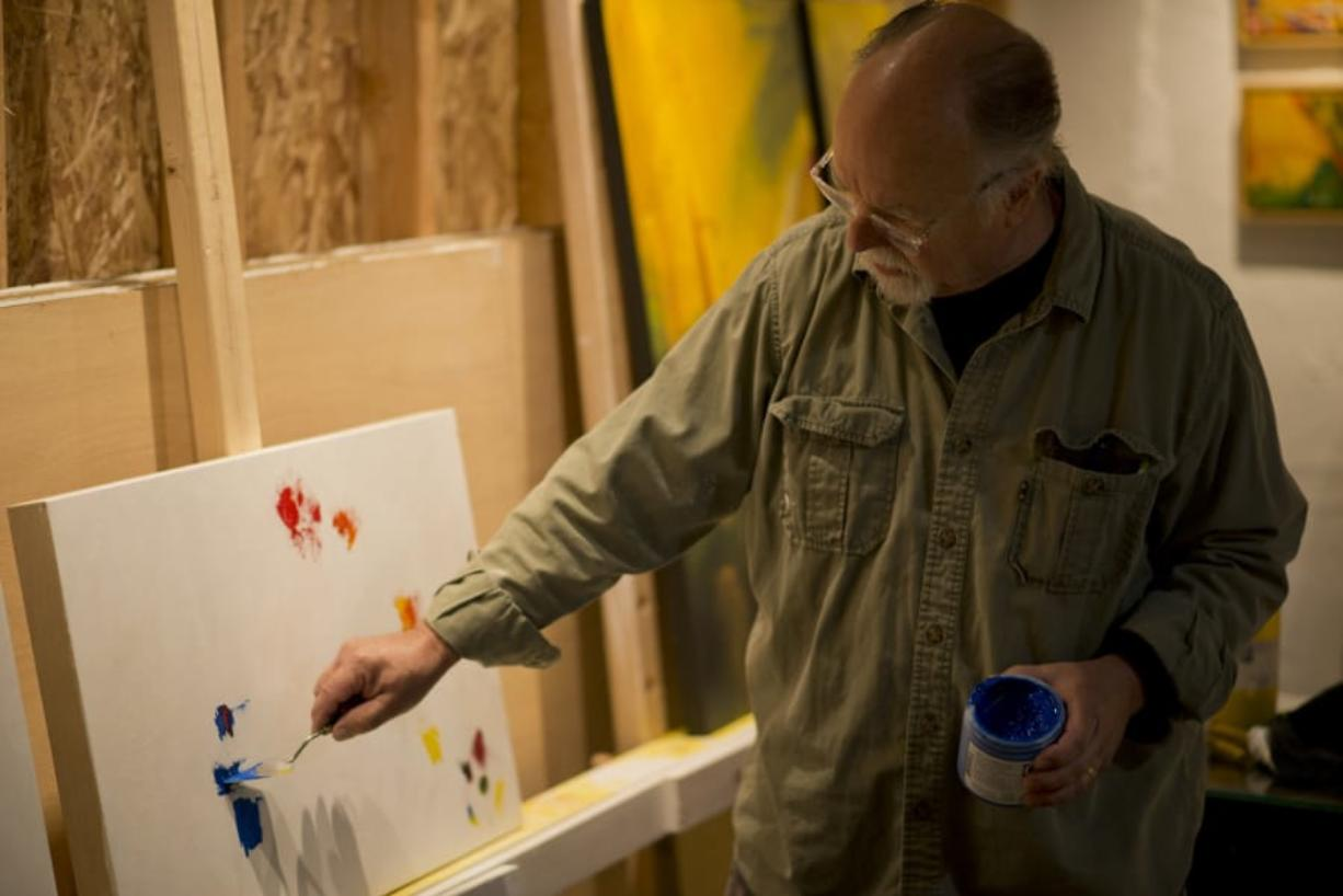 Artist Tom Relth shows visitors his work during the 2018 Clark County Open Studios tour.