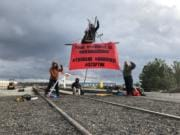 Demonstrators set up at the Port of Vancouver to protest the Trans Mountain Pipeline.