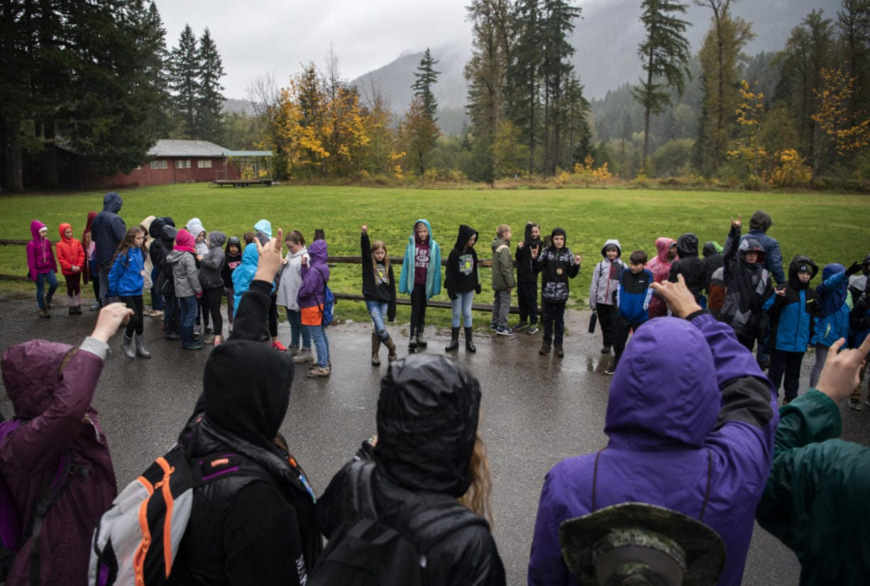 Students line up outside the cafeteria before going into lunch during the weeklong outdoor program at the Cispus Learning Center in Randle on Oct. 8.