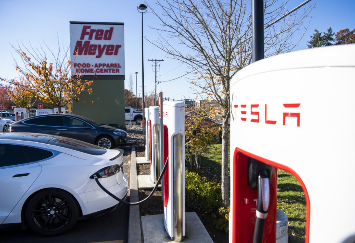Teslas charge at the Tesla Supercharger station in the Fred Meyer parking lot in Salmon Creek on Tuesday.