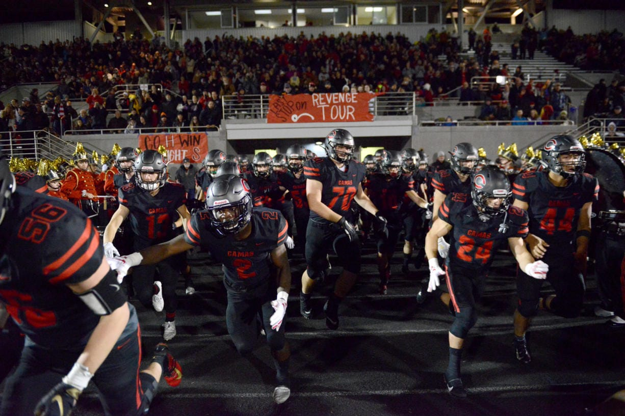 The Camas Papermakers enter Doc Harris Stadium to start the second half of a game against Union in Camas on Friday night, November 1, 2019. Camas beat Union 28-14. (Samuel Wilson for the Columbian)