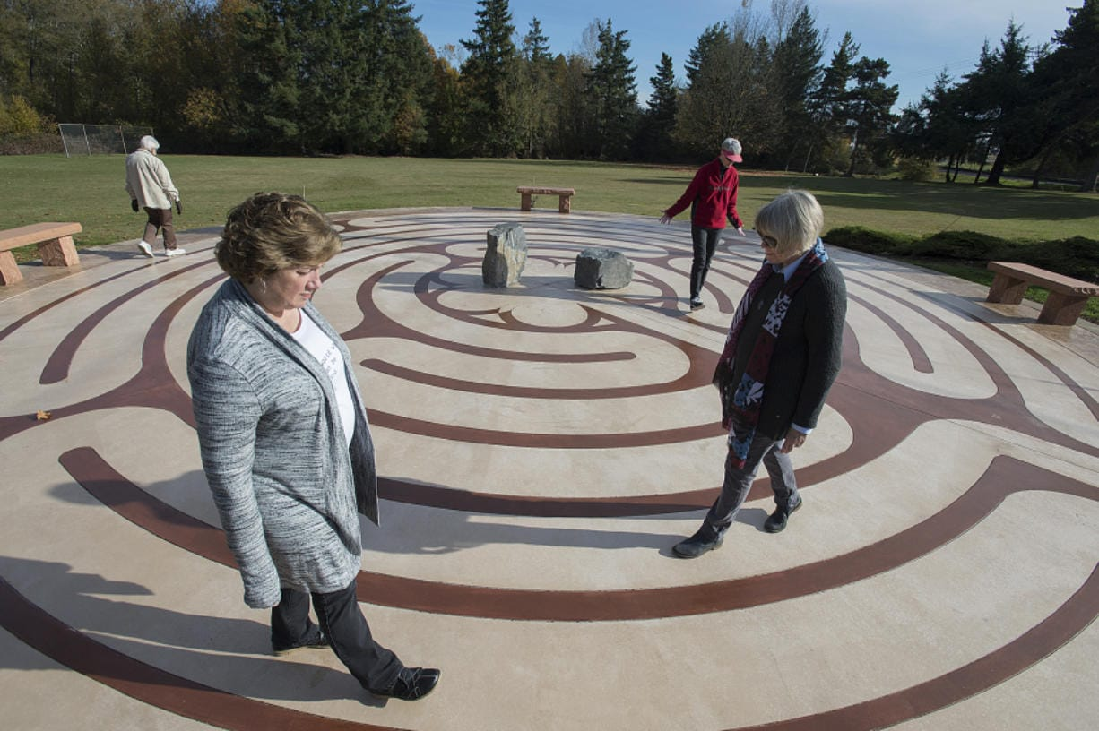 "Fae Jackson, left, and Penny Hammac first hatched the idea of building a labyrinth on the grounds of the Southridge Community of Christ church near the Clark County Fairgrounds. ""It's a beautiful, peaceful experience,"" said Hammac. ""It's a form of prayer or meditation, except you get to move."