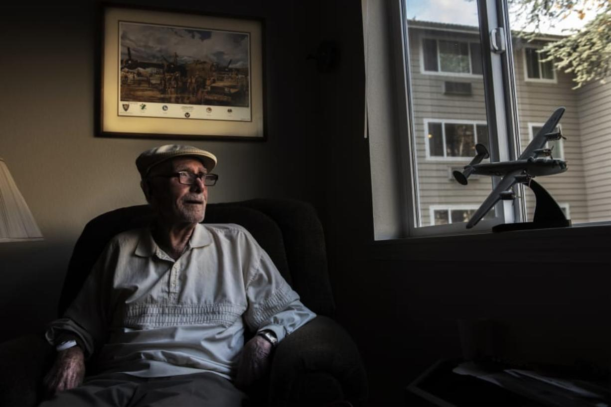 Harold McCarty, who flew 50 combat missions on a B-24 Liberator 75 years ago during World War II, has a model and print of the heavy bomber in his apartment at the Van Mall Retirement Community. Below, McCarty earned these decorations for his wartime service.