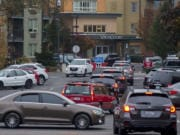Traffic backs up on West 14th Street as voters drop off ballots in downtown Vancouver on Election Day.
