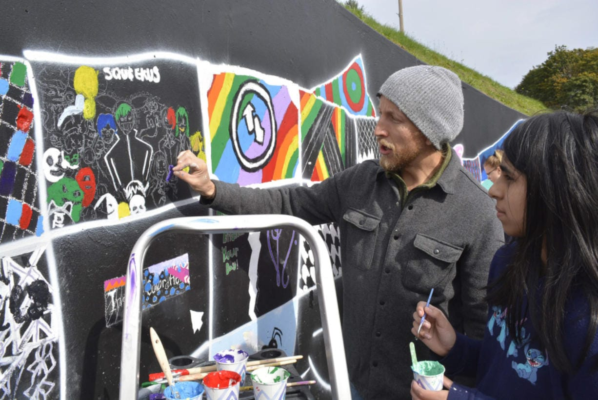 Washougal: Local muralist Travis London with Jemtegaard Middle School student Bianca Montoya, one of the students in the district's Club 8 after-school program who worked on a new mural in downtown Washougal.